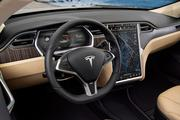 The interior of a Tesla Model S, with a 17-inch touch screen monitor. The 100-percent electric car sold 256 cars in 2013. Of those, 128 were sold in Dallas County.