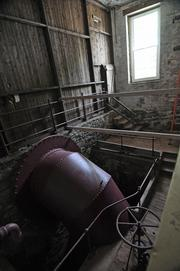 A turbine that once powered mill No. 4 with water drawn from a channel connected to Erie Canal Lock 5. The turbine, with a diameter of 6 feet, was discovered behind a brick wall during interior demolition. It will be preserved as a focal point inside the new apartment building.