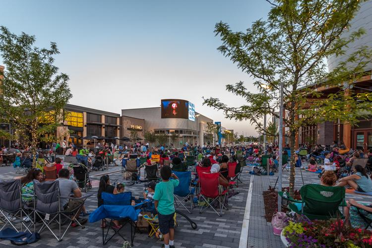 Families gather to watch a screening of Brave at Stonebridge at Potomac Town Center June 1.