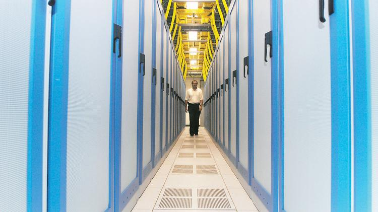 Rob McClary, Fortrust vice president, walks through a data center in 2008. Today, he predicts server modules and other advances will make future data centers far more energy efficient and compact than the industry's current best.