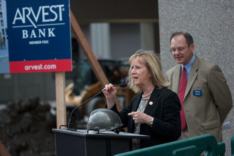 Fourth District Councilwoman Jan Marcason praised downtown development while Arvest Bank regional president Mark Larrabee looked on at the bank branch's groundbreaking on Tuesday.