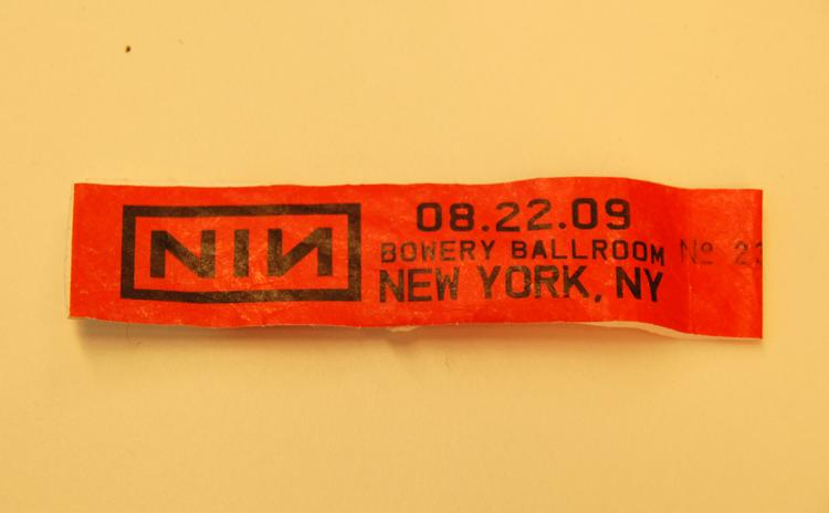 An admission bracelet from a show for the band Nine Inch Nails is shown on Aug. 31, 2009.  Tickets to this show were very hard to come by and the show was rumored to be the last ever by the band, but as it turns out, a new tour is planned for this fall. Will the band and Columbia Records be able to justify the investment?