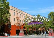 An exterior shot of the Farmers Union restaurant and bar, located on the left side of the San Pedro square arch at the intersection of San Pedro and Santa Clara streets.