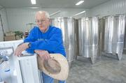 Mike Hatzell, owner of Brooks Hill Winery, is shown in his production room.
