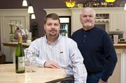 Brance Gould, seated, is owner of Forest Edge Winery. He is shown with winemaker Raymond Meyer.