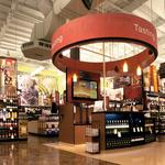 Which municipal liquor stores took a spill last year, and was Total Wine to blame?