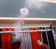 Mike Giles of Global Special Effects works a fog cannon at the company display.