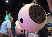 Guests check out the Soundsphere portable speaker system by FlexxUSA.