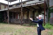 Martin Eakes, CEO of Durham-based nonprofit Self Help, shows off the back half of the massive Revolution Mill Studios property. The former Cone Mill textile facility dates back to the early 1900s.