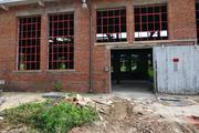 A joint venture of Greensboro-based Weaver Cooke Construction and Durham-based C.T. Wilson Construction has begun stabilizing work on the back half of the Revolution Mill property.