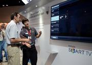A tech support assistant explains a Samsung Smart TV system to an Infocomm guest. The system controls room temperature, lighting, communication and, possibly, helps the viewer select television stations. Makes my TV look like an idiot.
