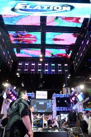 The roof may not be on fire, but it is a video display screen at the Elation Professional Lighting display.