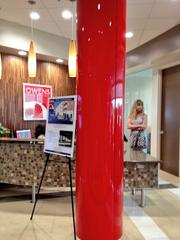 Michelle Earley, president of Clearwater-based interiors firm MLE Designs Inc., said the signature red pillar in the Owens Realty Services headquarters lobby was painted at an auto body shop.