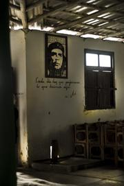 Che Guaverra icon on the wall at a cigar factory.