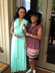 "Cynthia Bailey of reality TV show ""The Real Housewives of Atlanta"" (left) with One World Doll Project designer Stacey McBride-Irby, who designed for the Barbie line during her 15 years at Mattle Inc."