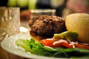 Pharmacy is described as a casual atmosphere with moderately priced appetizers, entrees and bar selections. Its menu also features local, seasonal, organic and sustainable foods.