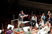 Music Director Giancarlo Guerrero leads a rehearsal of the Nashville Symphony. The 85-member orchestra is negotiating its labor contract, which expires in July.