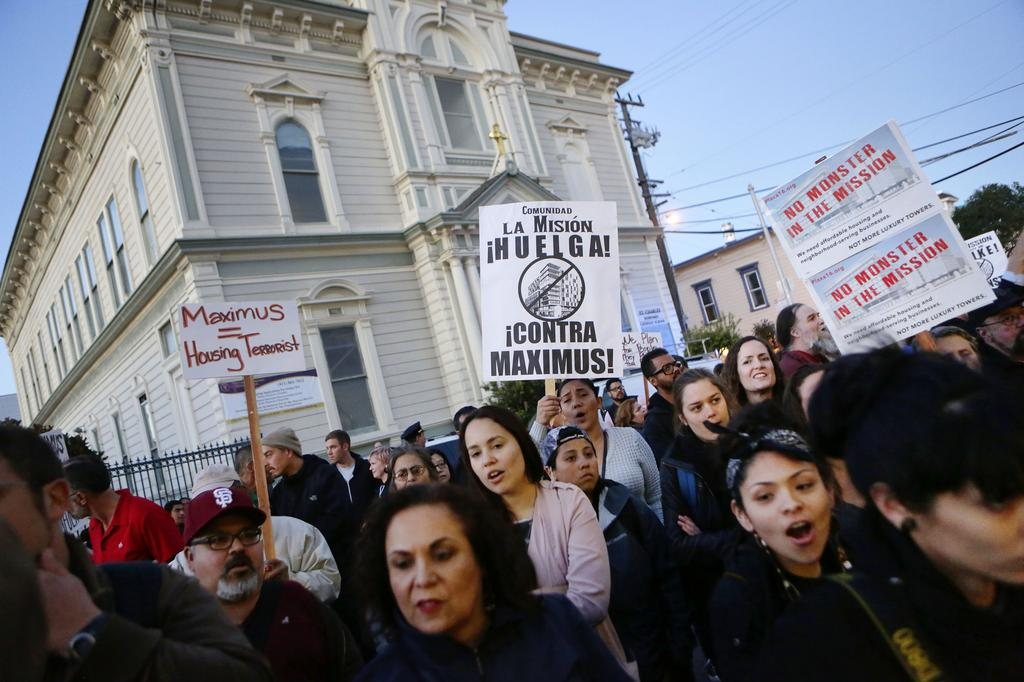 Demonstrators protest the proposals of Maximus Real Estate's development plan