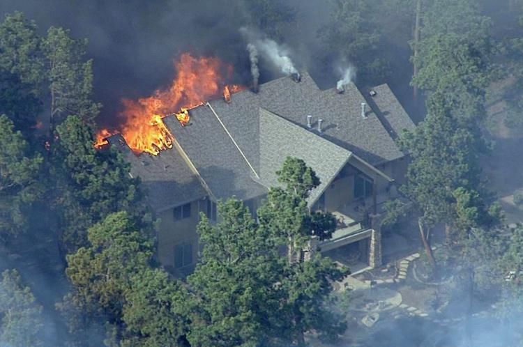 A home burns in the Black Forest Fire in this view Wednesday night from Copter4.