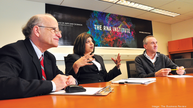RNA Institute director Paul Agris, left, appears in this December 2012 photo with Supriya Shivakumar and Josef Zihlmann, both of Sigma-Aldrich. The Institute has attracted more than $14 million in private and government research support.