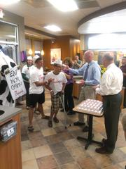 "CBJ Seen: Chick-fil-A opened its newest restaurant in Charlotte on May 30 at 6 a.m. on Rea Road. Operator/Owner Barry McAllaster hands out Chic-fil-A vouchers to early arriving customers. Want to have your company's events featured in CBJ Seen? Submit them to Alison Angel at aangel@bizjournals.com for consideration. Be sure to include caption information, and put ""CBJ Seen"" in the subject line."