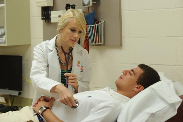 UC College of Medicine third-year student Meredith Harris practices on second-year student Kevin Janek.