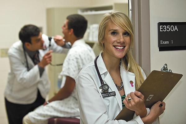 UC med student Meredith Harris isn't fazed by the perils of a career as a doctor. She expects to work for a hospital  system.