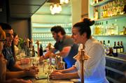 Chefs/owners Loren Falsone (right) and Dominick Tardugno (left) talk to guests behind the full liquor bar. The bar also features house-made bitters, tinctures, tonics and sodas.