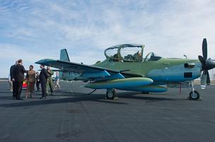 Embraers Super Tucano aircraft was on display for Lt. Gov. Jennifer Carroll and Rep. Ander Crenshaw, R.-Jacksonville, at Jacksonville International Airport in January 2011.