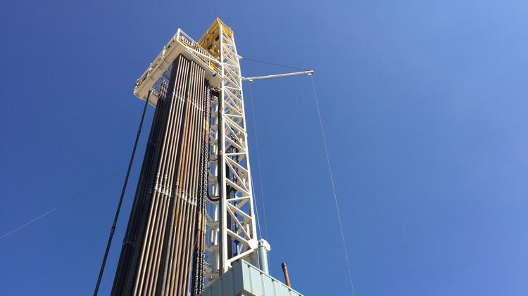 File photo of oil rig being used at a drilling site for Encana near Karnes City.