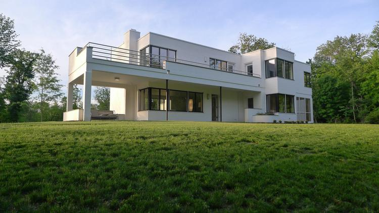 "Designed by John Becker, this house is considered his ""residential masterpiece."""