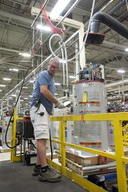 A GE employee worked with electrical compressors that are attached to the company's water heaters.