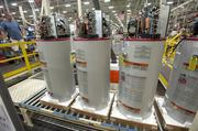 Nearly completed water heaters are shown on the line at Appliance Park.