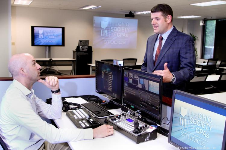 Scott Wiley, CEO of Ohio Society of CPAs, right, and Chris Loehrer, manager of multimedia, in the society's studio, where training videos are made.