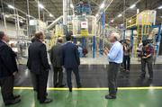GE product manager Tom Zimmer, at right, showed off the water heater manufacturing line during a media event Thursday.