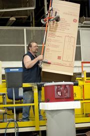 GE worker Wayne Lindle boxed a finished water heater.