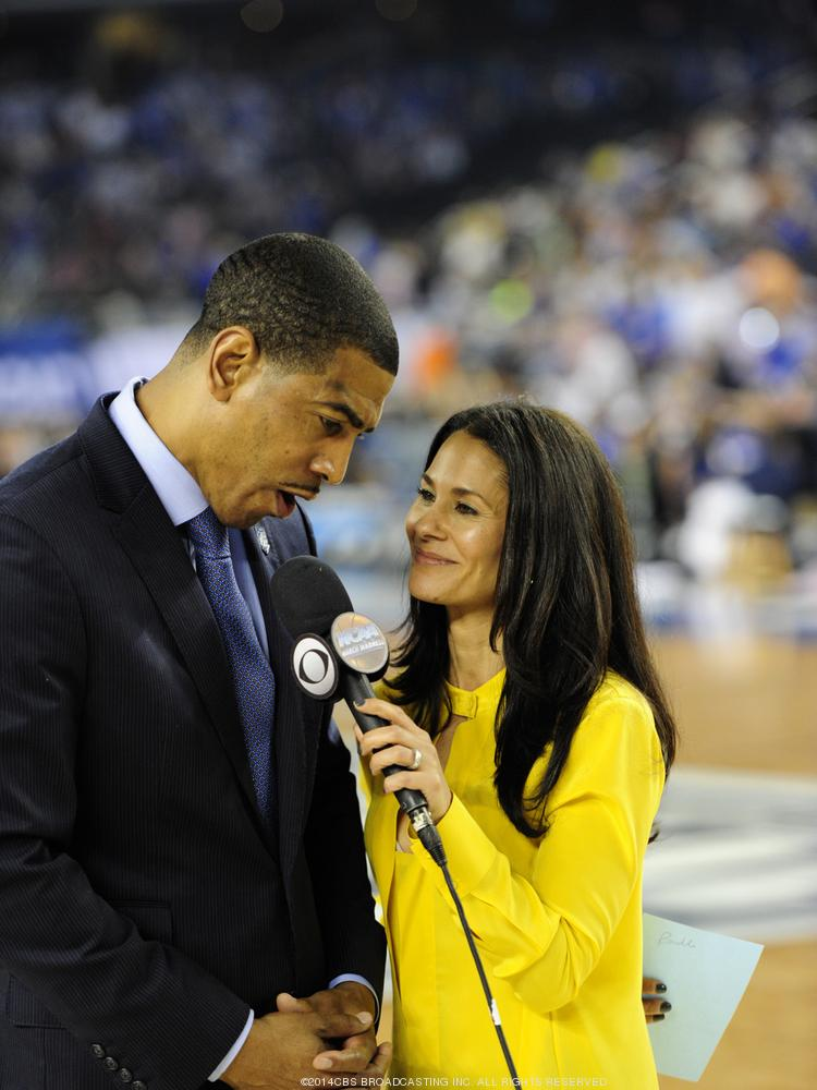 CBS reporter Tracy Wolfson interviewing winning UConn coach Kevin Ollie at the 2014 Final Four.