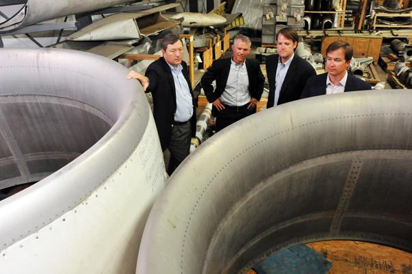 James Wingett, Jim Selberg, William Sherman Morris and Doug Duncan at Qwest Air Parts, which deals in used aircraft components.