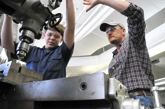 Student William Watson gets machinery training from instructor Curtis McLemore.