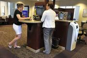 Fifth Third Bank's lobby at Birkdale has a banker stationed at small desktop to assist customers with transactions rather than behind a teller window.
