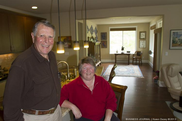 FIRST CITIZENS: Bob and Sherry Custer enjoy their new home at Pierce County's Trilogy at Tehaleh, where they became the first residents in February. Thirty-eight houses have sold so far.