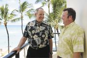 Outrigger Enterprises Group CEO David Carey, left, talks with Chief Marketing Officer Sean Dee on the lanai of the Outrigger Waikiki on the Beach. Dee was hired to help the company expand its international brand.