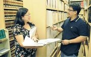 Cades Schutte is among the Hawaii law firms that are not quite ready to throw out the books. Librarians Debbie Oandasan and Cyril Calvo maintain the library, file reports, update the books, and do research for the firm's attorneys.
