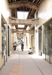 Union Way, a new Portland, Ore., pedestrian mall scheduled to open in August, blends historic touches including trusses with a modern aesthetic.