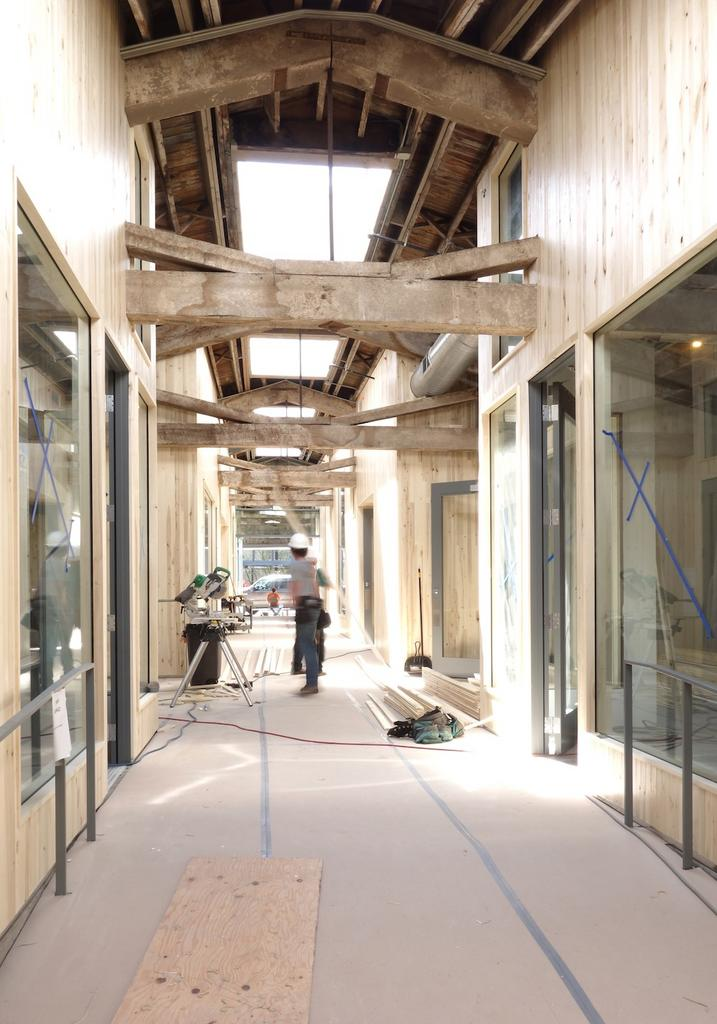 Union Way, a new Portland pedestrian mall scheduled to open in August, blends historic touches including trusses with a modern aesthetic.