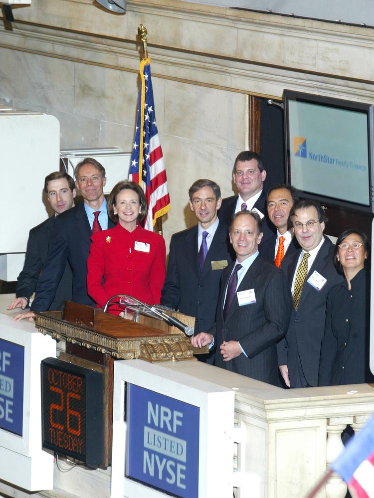 NorthStar Realty Finance Corp., seen here ringing the opening bell at the New York Stock Exchange, is buying Griffin-American Healthcare REIT II in a $3.35 billion deal.   Source:  NYSE/ via Bloomberg News.