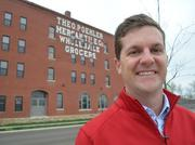 Developer Tony Krsnich is pictured in front of the Poehler Loft Apartments, which anchor the Warehouse Arts District he is developing just east of downtown Lawrence. Krsnich also will put his experience repurposing old properties to work on the Research Medical Center campus.