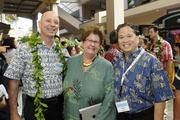 Michael Broderick, CEO of the YMCA of Honolulu; Nancy Pace of the Girl Scouts of Hawaii and Boys and Girls Club of Hawaii; and Marc Alexander, development director of IHS pose for a photo at the opening of the Microsoft Store at Ala Moana Center.