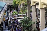 Crowds lined the mall at Ala Moana Center waiting for the opening of the Microsoft Store.