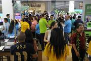 The first group of people allowed in to the new Microsoft Store, which opened Thursday at Ala Moana Center.
